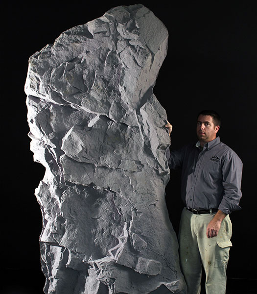 man-holding-rock
